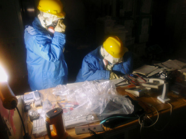 "<div class=""meta image-caption""><div class=""origin-logo origin-image ""><span></span></div><span class=""caption-text"">In this photo released by Nuclear and Industrial Safety Agency, Tokyo Electric Power Co. workers collect data in the control room for Unit 1 and Unit 2 at the tsunami-crippled Fukushima Dai-ichi nuclear power plant in Okumamachi, Fukushima Prefecture, Japan, Wednesday, March 23, 2011.  (AP Photo/Nuclear and Industrial Safety Agency)</span></div>"