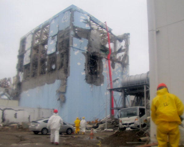 In this photo released by Tokyo Electric Power Co. &#40;TEPCO&#41; , workers in protective suits conduct cooling operation by spraying water at the damaged No. 4 unit of the Fukushima Dai-ichi nuclear complex in Okumamachi, northeastern Japan,Tuesday, March 22, 2011.  <span class=meta>(AP Photo&#47;Tokyo Electric Power Co.)</span>