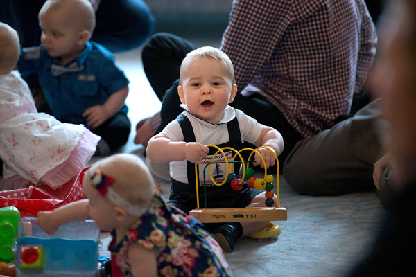 "<div class=""meta ""><span class=""caption-text "">Britain's Prince George, center, plays during a visit to Plunket nurse and parents group at Government House in Wellington, New Zealand, Wednesday, April 9, 2014. Plunket is a national not-for-profit organization that provides care for children and families in New Zealand. Britain's Prince William, his wife Kate, the Duchess of Cambridge and their son, Prince George, are on a three-week tour of New Zealand and Australia. (AP Photo/Marty Melville, Pool)  </span></div>"