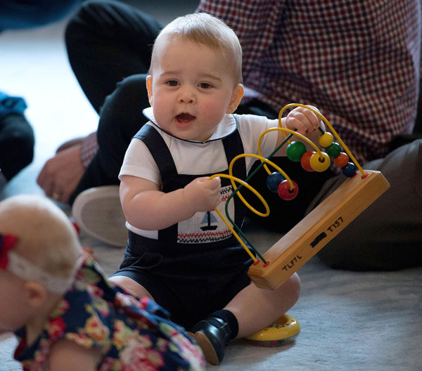 "<div class=""meta ""><span class=""caption-text "">Britain's Prince George plays during a visit to Plunket nurse and parents group at Government House in Wellington, New Zealand, Wednesday, April 9, 2014. Plunket is a national not-for-profit organization that provides care for children and families in New Zealand. Britain's Prince William, his wife Kate, the Duchess of Cambridge and their son, Prince George, are on a three-week tour of New Zealand and Australia. (AP Photo/Marty Melville, Pool)          </span></div>"