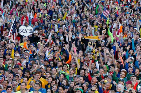 A crowd gathers at the finish line of the Boston Marathon in Boston for a Sports Illustrated photo shoot before the one-year anniversary of the Boston Marathon bombings, Saturday, April 12, 2014.  <span class=meta>(AP Photo&#47; Michael Dwyer)</span>