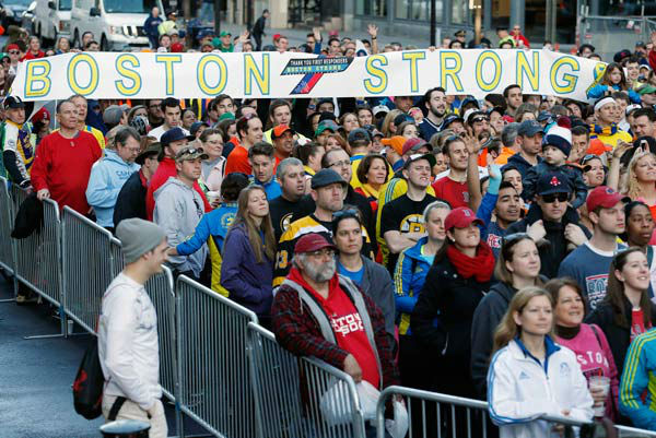 "<div class=""meta image-caption""><div class=""origin-logo origin-image ""><span></span></div><span class=""caption-text"">A crowd gathers at the finish line of the Boston Marathon in Boston for a Sports Illustrated photo shoot before the one-year anniversary of the Boston Marathon bombings, Saturday, April 12, 2014.  (AP Photo/ Michael Dwyer)</span></div>"