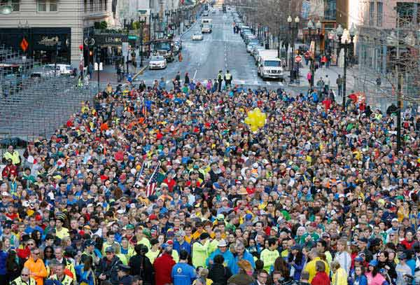 A crowd gathers at the finish line of the Boston Marathon in Boston for a Sports Illustrated photo shoot to commemorate the one-year anniversary of the Boston Marathon bombing, Saturday, April 12, 2014.  <span class=meta>(AP Photo&#47; Michael Dwyer)</span>