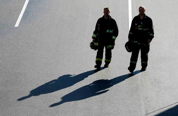 A pair of firefighters arrive at the finish line of the Boston Marathon in Boston for a Sports Illustrated photo shoot to commemorate the one-year anniversary of the Boston Marathon bombing, Saturday, April 12, 2014.  <span class=meta>(AP Photo&#47; Michael Dwyer)</span>