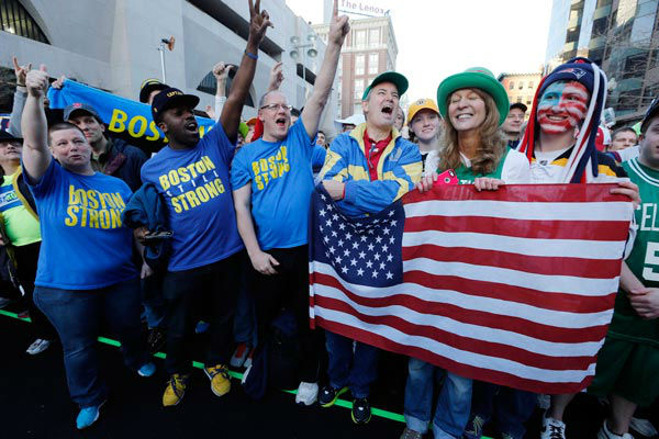 A crowd gathers at the finish line of the Boston Marathon in Boston for a Sports Illustrated photo shoot to commemorate the one-year anniversary of the Boston Marathon bombings, Saturday, April 12, 2014.  <span class=meta>(AP Photo&#47; Michael Dwyer)</span>