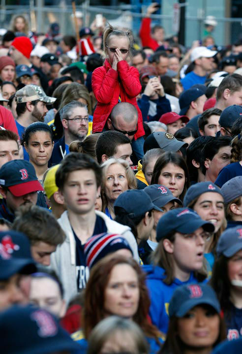 "<div class=""meta ""><span class=""caption-text "">A crowd gathers at the finish line of the Boston Marathon in Boston for a Sports Illustrated photo shoot before the one-year anniversary of the Boston Marathon bombings, Saturday, April 12, 2014.  (AP Photo/ Michael Dwyer)</span></div>"