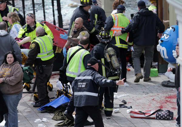 "<div class=""meta ""><span class=""caption-text "">Medical workers aid injured people at the finish line of the 2013 Boston Marathon following an explosion in Boston, Monday, April 15, 2013.  (AP Photo/Charles Krupa)</span></div>"