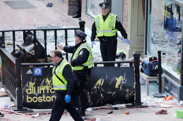 Boston police clear an area following an explosion near the finish line of the 2013 Boston Marathon in Boston, Monday, April 15, 2013. Two explosions shattered the euphoria of the Boston Marathon finish line on Monday, sending authorities out on the course to carry off the injured while the stragglers were rerouted away from the smoking site of the blasts.  <span class=meta>(AP Photo&#47;Charles Krupa)</span>