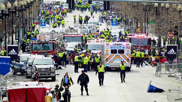 Police clear the area at the finish line of the 2013 Boston Marathon as medical workers help injured following explosions in Boston, Monday, April 15, 2013. The explosions near the finish of the Boston Marathon on Monday, killied at least two people, injuring over 20 others.  <span class=meta>(AP Photo&#47;Charles Krupa)</span>
