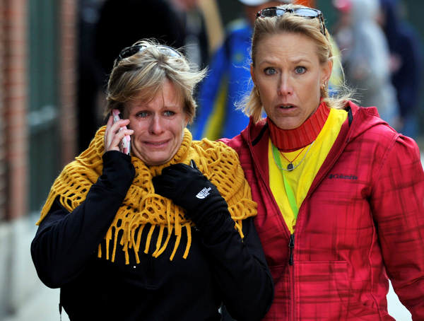Women react as they walk from the area where there was an explosion after the Boston Marathon in Boston, Monday, April 15, 2013.  <span class=meta>(AP Photo&#47;Josh Reynolds)</span>