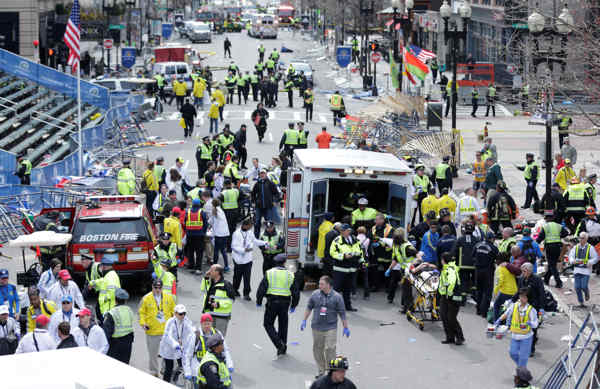 Medical workers aid injured people at the finish line of the 2013 Boston Marathon following an explosion in Boston, Monday, April 15, 2013.  <span class=meta>(AP Photo&#47;Charles Krupa)</span>