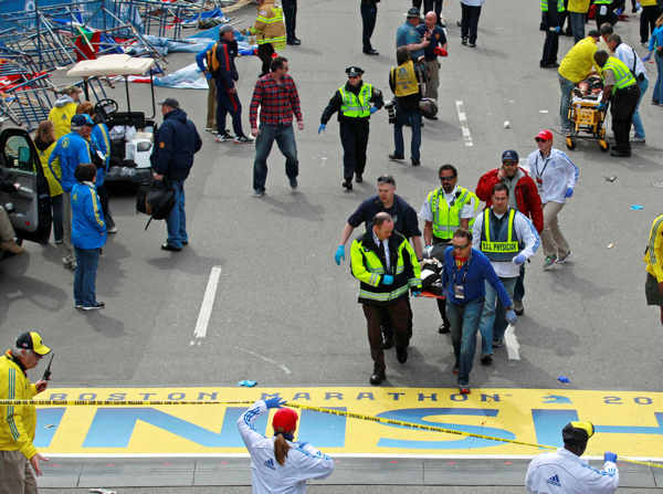 Medical workers wheel the injured across the finish line during the 2013 Boston Marathon following an explosion in Boston, Monday, April 15, 2013. Two explosions shattered the euphoria of the Boston Marathon finish line on Monday, sending authorities out on the course to carry off the injured while the stragglers were rerouted away from the smoking site of the blasts.  <span class=meta>(AP Photo&#47;Charles Krupa)</span>
