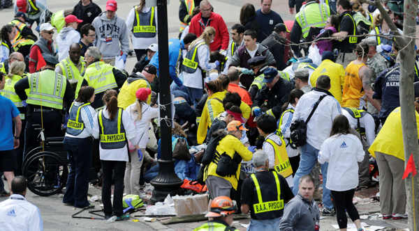 Medical workers aid injured people at the finish line of the 2013 Boston Marathon following an explosion in Boston, Monday, April 15, 2013. Two explosions shattered the euphoria of the Boston Marathon finish line on Monday, sending authorities out on the course to carry off the injured while the stragglers were rerouted away from the smoking site of the blasts.  <span class=meta>(AP Photo&#47;Charles Krupa)</span>