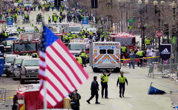 "<div class=""meta ""><span class=""caption-text "">Emergency workers aid injured people at the finish line of the 2013 Boston Marathon following an explosion in Boston, Monday, April 15, 2013.  (AP Photo/Charles Krupa)</span></div>"
