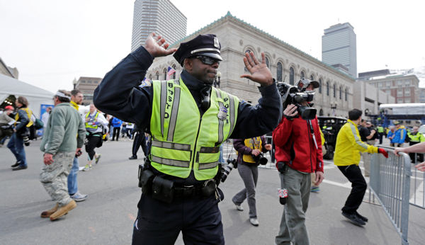 "<div class=""meta image-caption""><div class=""origin-logo origin-image ""><span></span></div><span class=""caption-text"">A Boston police officer clears Boylston Street following an explosion at the finish line of the 2013 Boston Marathon in Boston, Monday, April 15, 2013. Two explosions shattered the euphoria at the finish line on Monday, sending authorities out on the course to carry off the injured while the stragglers were rerouted away from the smoking site of the blasts.  (AP Photo/Charles Krupa)</span></div>"