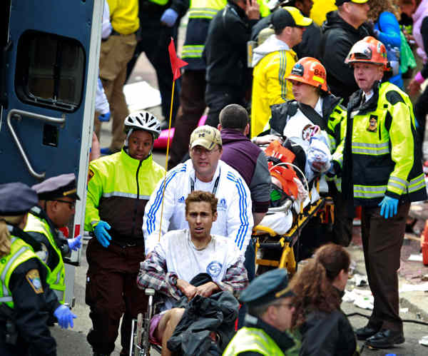 Medical workers aid injured people at the finish line of the 2013 Boston Marathon following an explosion Monday, April 15, 2013 in Boston. Two bombs exploded near the finish line of the marathon on Monday, killing at least two people, injuring at least 22 others and sending authorities rushing to aid wounded spectators. <span class=meta>(AP Photo&#47;Charles Krupa)</span>
