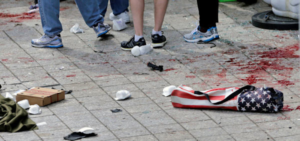 Blood from victims covers the sidewalk on Boylston Street, at the site of an explosion during the 2013 Boston Marathon in Boston, Monday, April 15, 2013. At the right foreground is a folding chair with the design of an American flag on the cover. Two explosions shattered the euphoria of the Boston Marathon finish line on Monday, sending authorities out on the course to carry off the injured while the stragglers were rerouted away from the smoking site of the blasts. <span class=meta>(AP Photo&#47;Charles Krupa)</span>