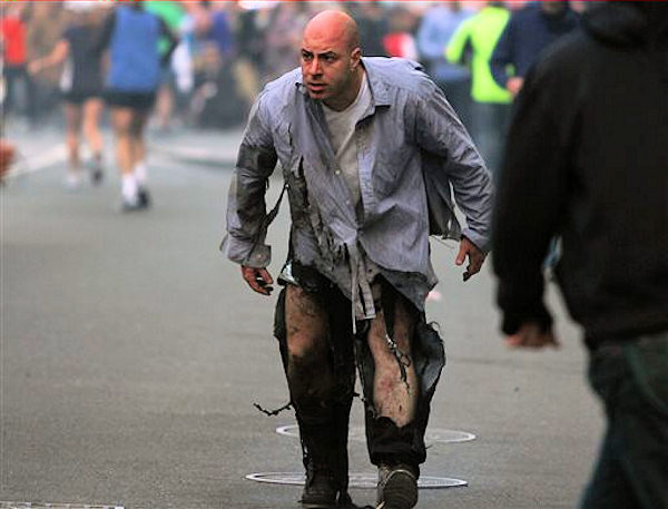 In this photo provided by The Daily Free Press and Kenshin Okubo, a man reacts to an explosion at the 2013 Boston Marathon in Boston, Monday, April 15, 2013. Two explosions shattered the euphoria of the Boston Marathon finish line on Monday, sending authorities out on the course to carry off the injured while the stragglers were rerouted away from the smoking site of the blasts.  <span class=meta>(AP Photo&#47;The Daily Free Press, Kenshin Okubo)</span>