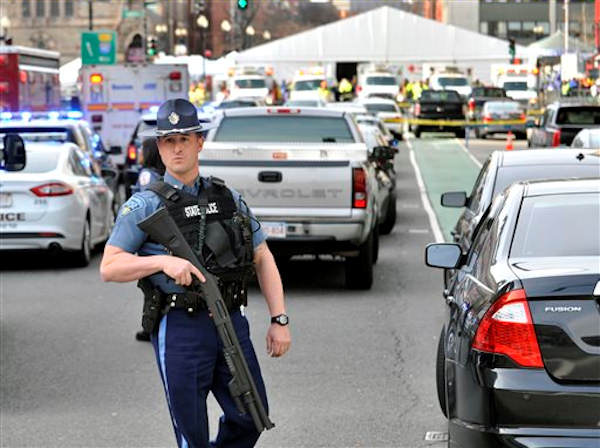 A Massachusetts state police officer guards the area containing the medical tent, rear, following an explosion at the 2013 Boston Marathon in Boston, Monday, April 15, 2013. Two explosions shattered the euphoria of the Boston Marathon finish line on Monday, sending authorities out on the course to carry off the injured while the stragglers were rerouted away from the smoking site of the blasts.  <span class=meta>(AP Photo&#47;Josh Reynolds)</span>
