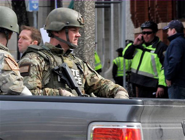 Armed Massachusetts State Police roll into the area following an explosion at the 2013 Boston Marathon in Boston, Monday, April 15, 2013. Two explosions shattered the euphoria of the Boston Marathon finish line on Monday, sending authorities out on the course to carry off the injured while the stragglers were rerouted away from the smoking site of the blasts. <span class=meta>(AP Photo&#47;Josh Reynolds)</span>