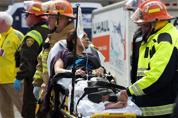 "<div class=""meta ""><span class=""caption-text "">Emergency responders aid a woman on a stretcher who was injured in a bomb blast near the finish line of the Boston Marathon Monday, April 15, 2013 in Boston.  (AP Photo/Jeremy Pavia)</span></div>"