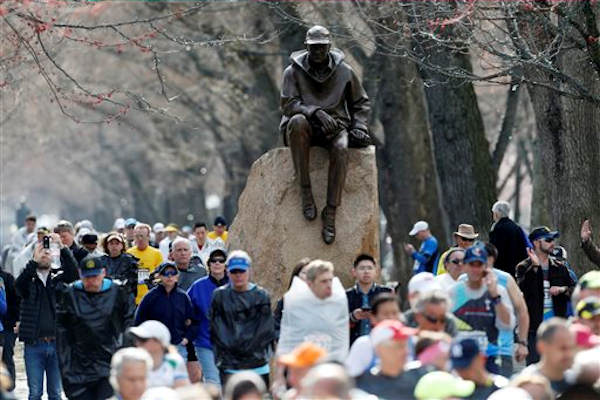 Runners who were diverted from the race course walk on the Commonwealth Mall two blocks from the site of an explosion at the finish line of the Boston Marathon in Boston, Monday, April 15, 2013. <span class=meta>(AP Photo&#47;Michael Dwyer)</span>