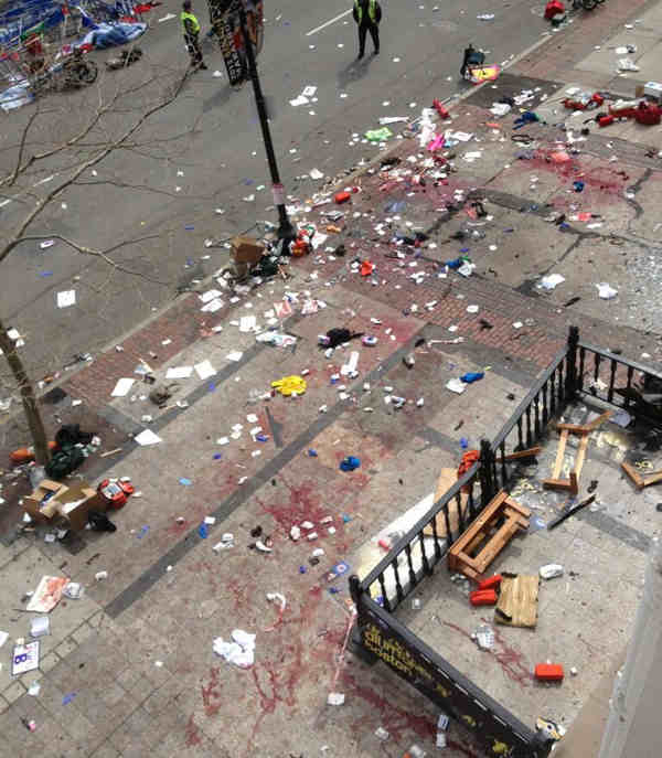 This photo provided by Bruce Mendelsohn shows the scene after two explosions occurred during the 2013 Boston Marathon in Boston, Monday, April 15, 2013. Two explosions shattered the euphoria of the Boston Marathon finish line on Monday, sending authorities out on the course to carry off the injured while the stragglers were rerouted away from the smoking site of the blasts.  <span class=meta>(AP Photo&#47; Bruce Mendelsohn)</span>