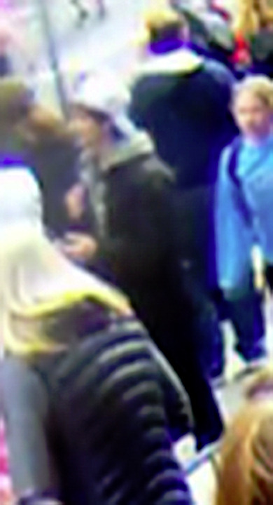 The FBI released the following photos of two suspects in the Boston Marathon bombings during a press conference on Thursday, April 18, 2013. Suspect #1 is wearing a dark hat. Suspect #2 is wearing a white hat.