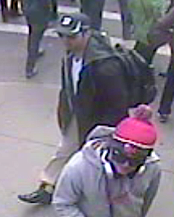 "<div class=""meta image-caption""><div class=""origin-logo origin-image ""><span></span></div><span class=""caption-text"">The FBI released the following photos of two suspects in the Boston Marathon bombings during a press conference on Thursday, April 18, 2013. Suspect #1 is wearing a dark hat. Suspect #2 is wearing a white hat. </span></div>"