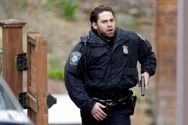 "<div class=""meta image-caption""><div class=""origin-logo origin-image ""><span></span></div><span class=""caption-text"">A police officer runs with his weapon drawn as he conduct a search for a suspect in the Boston Marathon bombings, Friday, April 19, 2013, in Watertown, Mass. Two suspects in the Boston Marathon bombing killed an MIT police officer, injured a transit officer in a firefight and threw explosive devices at police during a getaway attempt in a long night of violence that left one of them dead and another still at large Friday, authorities said as the manhunt intensified for a young man described as a dangerous terrorist.  (AP Photo/Matt Rourke)</span></div>"