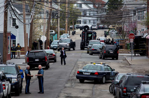 Police presence grows in the neighborhoods of Watertown, Mass., Friday, April 19, 2013, as a massive search involving hundreds of heavily armed law enforcement officials continues for one of two suspects in the Boston Marathon bombing. A second suspect died in the early morning hours in a car chase and gun battle overnight that left one of them dead and his brother on the loose, authorities said Friday.  <span class=meta>(AP Photo&#47;Craig Ruttle)</span>