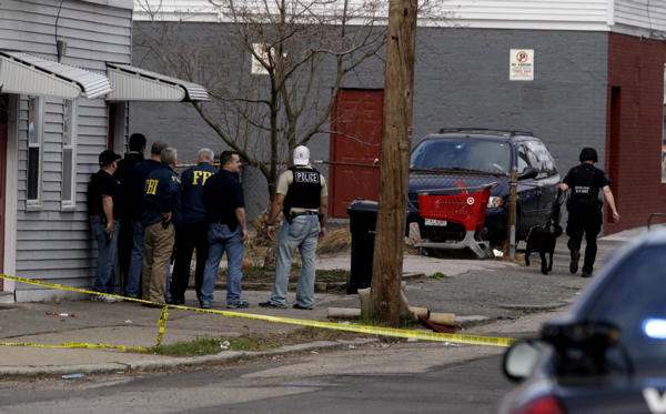 Law enforcement officials stand guard while searching for an individual believed to be involved in the Boston Marathon explosions in Watertown, Mass., Friday, April 19, 2013. The two suspects in the Boston Marathon bombing killed an MIT police officer and hurled explosives at police in a car chase and gun battle overnight that left one of them dead and his brother on the loose, authorities said Friday.  <span class=meta>(AP Photo&#47;Julio Cortez)</span>