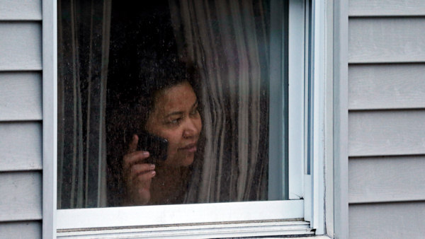 "<div class=""meta ""><span class=""caption-text "">A woman looks out a window at her home as police start to search an apartment building while looking for a suspect in the Boston Marathon bombings in Watertown, Mass., Friday, April 19, 2013. Two suspects in the Boston Marathon bombing killed an MIT police officer, injured a transit officer in a firefight and threw explosive devices at police during their getaway attempt in a long night of violence that left one of them dead and another still at large Friday, authorities said as the manhunt intensified for a young man described as a dangerous terrorist.  (AP Photo/Charles Krupa)</span></div>"