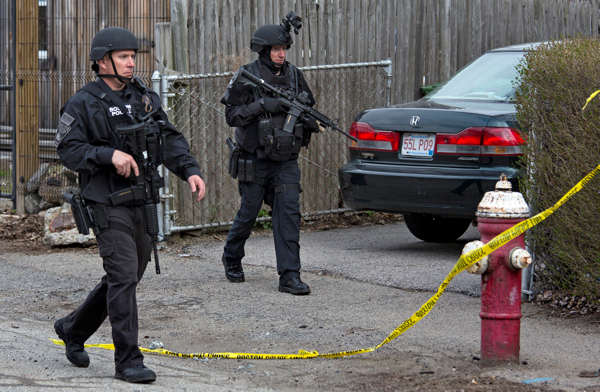 "<div class=""meta ""><span class=""caption-text "">Police continue to patrol the neighborhoods of Watertown, Mass. Friday, April 19, 2013, as a massive search continued for one of two suspects in the Boston Marathon bombing. A second suspect died in the early morning hours after an encounter with law enforcement.  (AP Photo/Craig Ruttle)</span></div>"