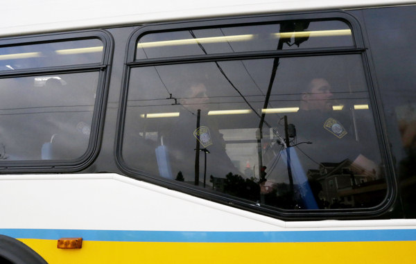 "<div class=""meta ""><span class=""caption-text "">A bus with law enforcement agents travels through Watertown, Mass., Friday, April 19, 2013. All residents of Boston were ordered to stay in their homes Friday morning as the search for the surviving suspect in the marathon bombings continued after a long night of violence that left another suspect dead.  (AP Photo/Julio Cortez)</span></div>"