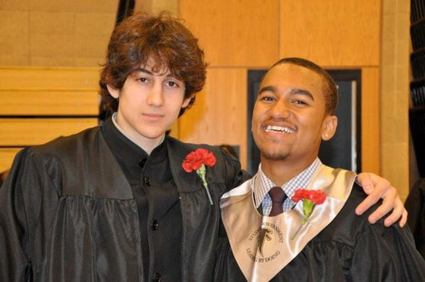 In this undated photo provided by Robin Young, Dzhokhar A. Tsarnaev, left, and Here &#38; Now host Robin Young&#39;s nephew, right, pose for a photo after graduating from Cambridge Rindge and Latin High School. Tsarnaev has been identified as the surviving suspect in the marathon bombings. Two suspects in the Boston Marathon bombing killed an MIT police officer, injured a transit officer in a firefight and threw explosive devices at police during a getaway attempt in a long night of violence that left one of them dead and another still at large Friday, April 19, 2013.  <span class=meta>(AP Photo&#47;Robin Young)</span>