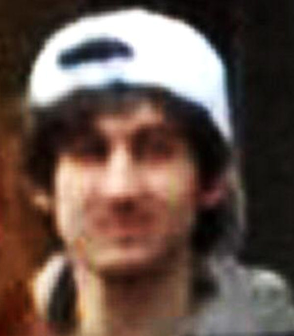 The FBI released the following photos of two suspects in the Boston Marathon bombings on Thursday, April 18, 2013. Suspect #1 is wearing a dark hat. Suspect #2 is wearing a white hat.