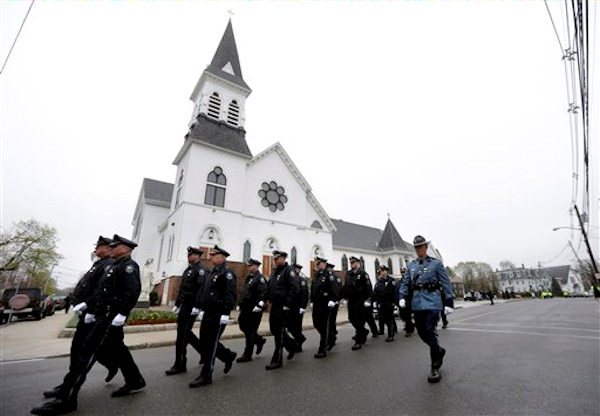"<div class=""meta ""><span class=""caption-text "">Pictured: The funeral Mass for Massachusetts Institute of Technology police officer Sean Collier on Tuesday, April 23, 2013. Collier was fatally shot on the MIT campus Thursday, April 18, 2013. Authorities allege that the Boston Marathon bombing suspects were responsible. (AP Photo/Steven Senne)</span></div>"