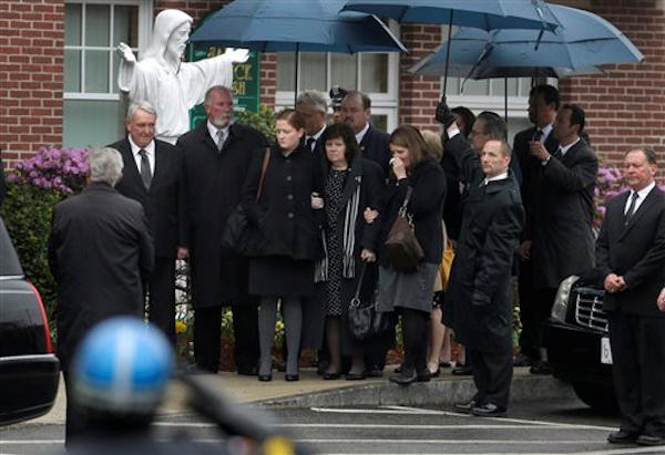 Pictured: The funeral Mass for Massachusetts Institute of Technology police officer Sean Collier on Tuesday, April 23, 2013. Collier was fatally shot on the MIT campus Thursday, April 18, 2013. Authorities allege that the Boston Marathon bombing suspects were responsible. (AP Photo/Steven Senne)