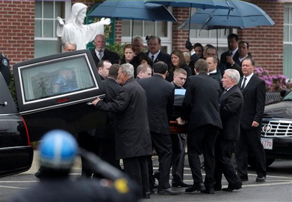 "<div class=""meta image-caption""><div class=""origin-logo origin-image ""><span></span></div><span class=""caption-text"">Pictured: The funeral Mass for Massachusetts Institute of Technology police officer Sean Collier on Tuesday, April 23, 2013. Collier was fatally shot on the MIT campus Thursday, April 18, 2013. Authorities allege that the Boston Marathon bombing suspects were responsible. (AP Photo/Steven Senne)</span></div>"