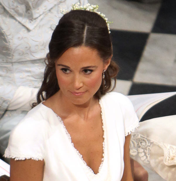 "<div class=""meta ""><span class=""caption-text "">Pippa Middleton, the sister of Kate Middleton, sits in the pews of Westminster Abbey, in London during the wedding ceremony of Prince William and Kate Middleton Friday April 29, 2011.  (AP Photo/Clara Molden, Pool)</span></div>"
