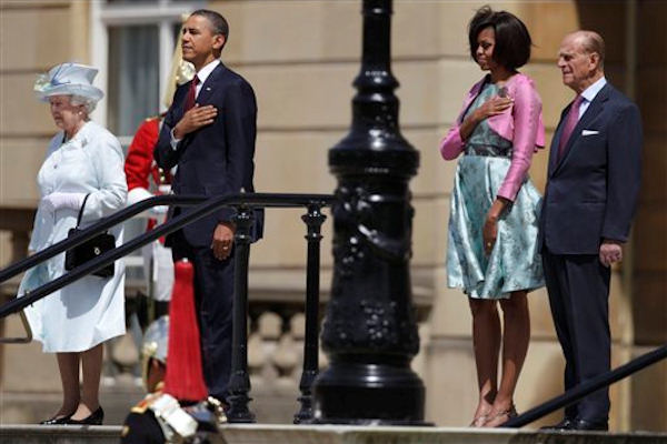 "<div class=""meta image-caption""><div class=""origin-logo origin-image ""><span></span></div><span class=""caption-text"">President Barack Obama and first lady Michelle Obama along with Britain's Queen Elizabeth II and Prince Philip view members of the Guard of Honor of the Scots Guard during an official arrival ceremony from the Terrace Stairs of Buckingham Palace in London, Tuesday, May 24, 2011.  (AP Photo/Carolyn Kaster)</span></div>"