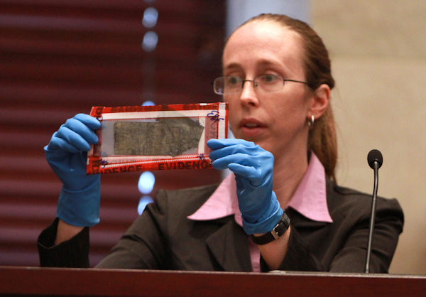 Jennifer Welch, a crime scene investigator with the Orange County Sheriffs Office, holds up duct tape entered in evidence during the trial of Casey Anthony, Saturday, June 11, 2011, at the Orange County Courthouse, in Orlando, Fla. Anthony, 25, is charged with murder in the 2008 death of her daughter Caylee. (AP Photo/Joe Burbank, Pool)