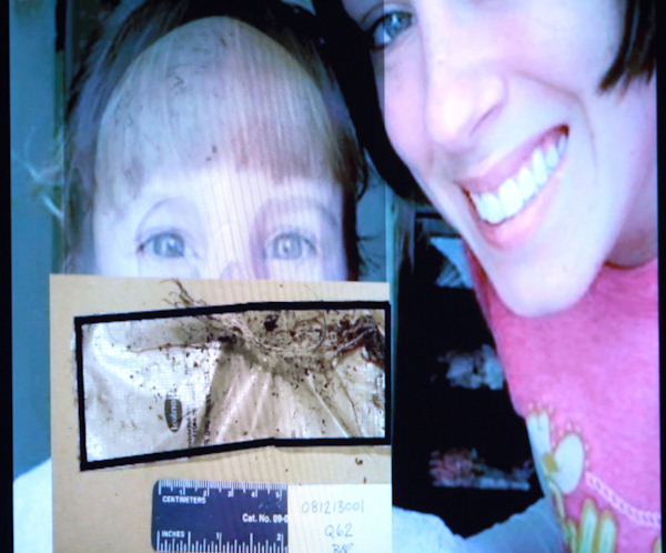 An image displayed on a courtroom monitor shows a photo entered into evidence in the Casey Anthony trial at the Orange County Courthouse on Friday, June 10, 2011. The photo shows Caylee Anthony and her mother Casey. An expert witness used this photo to superimpose an image of Caylee's skull to mark where duct tape found on the remains would have been positioned on the child when she was alive. (AP Photo/Joe Burbank, Pool)