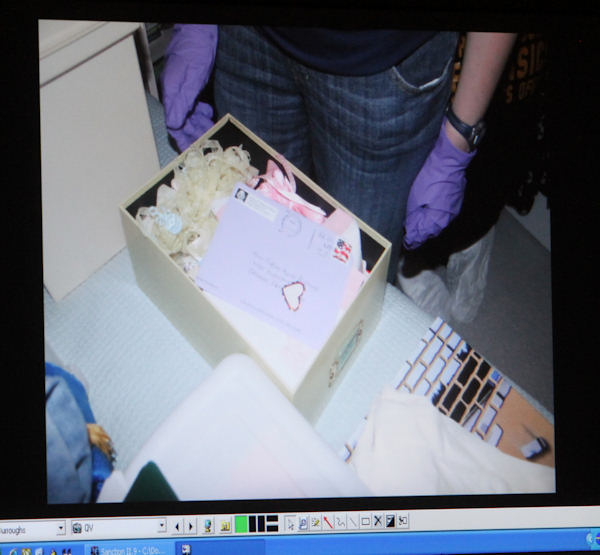 A photograph of an envelope with a heart shaped sticker on it that was found in the Anthony home is displayed on a monitor after being entered into evidence during day 18 of the Casey Anthony murder trial at the Orange County Courthouse, in Orlando, Fla., Tuesday, June 14, 2011. Anthony, 25, is charged with killing her 2-year old daughter in 2008. (AP Photo/Red Huber, Pool)