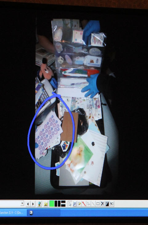 A photograph of stickers found in the Anthony home is displayed on a monitor after being entered into evidence during day 18 of the Casey Anthony murder trial at the Orange County Courthouse, in Orlando, Fla., Tuesday, June 14, 2011. Anthony, 25, is charged with killing her 2-year old daughter in 2008. (AP Photo/Red Huber, Pool)