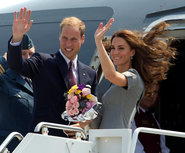 Prince William and Kate, the Duke and Duchess of Cambridge, wave as they board their plane as they leave Ottawa, Ontario , en route to Montreal as they continue their Royal Tour of Canada Saturday, July 2, 2011. (AP Photo/Charlie Riedel)