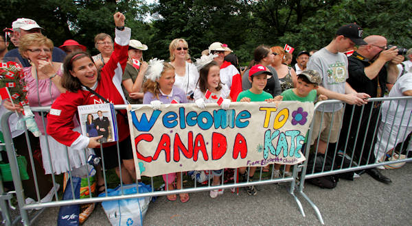 Fans wait to greet Prince William and wife Kate, the Duke and Duchess of Cambridge before the Official Welcome Ceremony to Canada at Rideau Hall in Ottawa, Ontario, on their first official overseas trip Thursday, June 30, 2011. (AP Photo/Charlie Riedel)