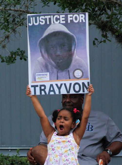 "<div class=""meta ""><span class=""caption-text "">Hanna Brianna, 5, holds a sign in front of her home in the Goldsboro Historical neighborhood, Saturday, July 13, 2013, in Sanford, Fla. while residents wait for word on the verdict in the George Zimmerman trial. Zimmerman is charged with the 2012 shooting death of Trayvon Martin. (AP Photo/Mike Brown)</span></div>"