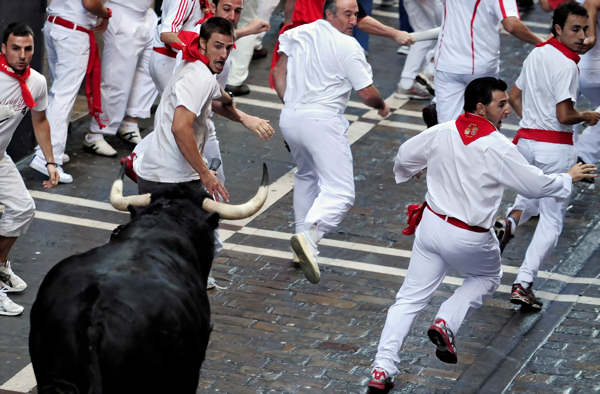 Revelers run from a Dolores Aguirre Ybarra ranch fighting bull, during the fourth run of the San Fermin fiestas in Pamplona northern Spain, Saturday July 10, 2010. &#40;AP Photo&#47;Alvaro Barrientos&#41; <span class=meta>(AP Photo&#47;Alvaro Barrientos)</span>